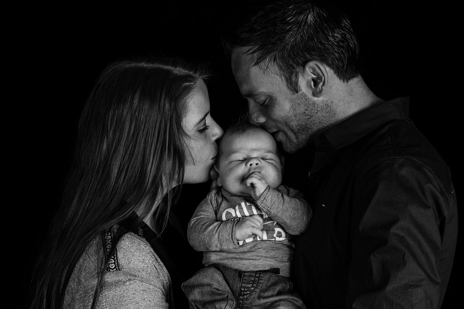 Samen met papa en mama op de foto